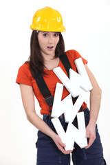 Female builder holding large WWW letters
