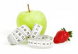 Measuring tape wrapped around apple as a symbol of diet