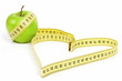 Tape measure heart shape and apple  - health, weight concept