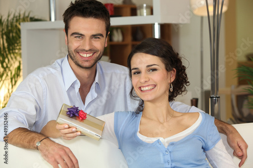 Husband giving his wife present