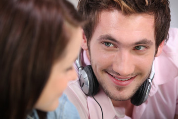 young man and woman listening music at home