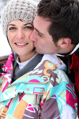 Affection couple stood in snow