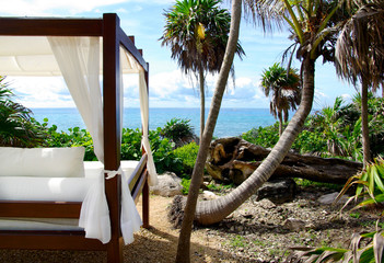 White bed on the beach