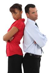 couple standing back to back after quarrel