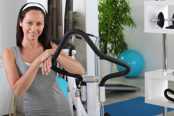 Woman standing next to an exercise machine