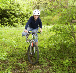 young boy with mountain bike on tour