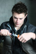 young electrician using pliers