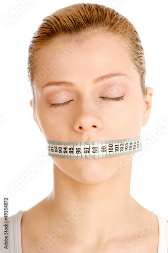 A woman has a tape around her mouth.