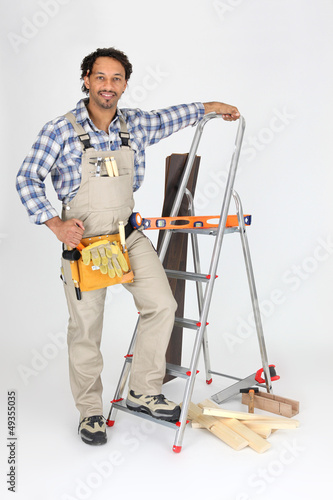Carpenter stood with ladder