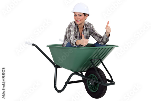 Female worker in a wheelbarrow