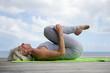 Woman doing yoga on jetty