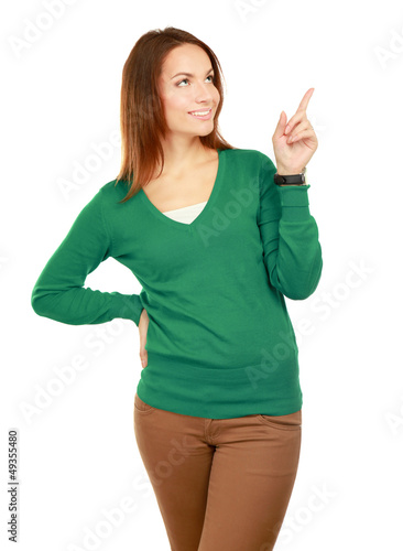 Woman pointing up at copy space over white background