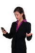 Angry woman reading a text message