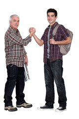 Manual worker welcoming intern