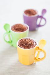 Dessert of cream cheese, yogurt and chocolate in coffee cup