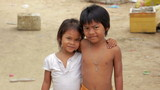 cambodian kids in slums near phnom penh city dumping area