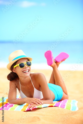 Happy beach woman laughing having fun