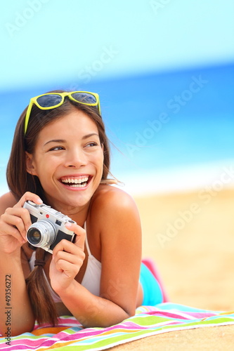 Summer beach woman fun holding camera