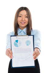 Asian business woman holding reports and smiling. Copy space
