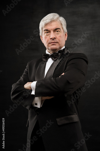 Portrait of a successful mature business man smiling - Copyspace