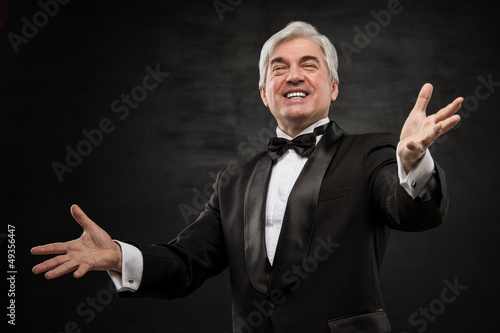 Champion business man standing with hands opened in victory