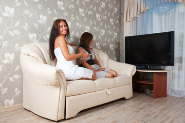 Relaxed women looking TV