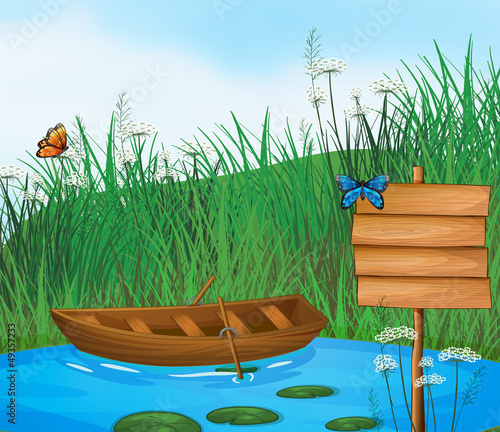 Poster Vlinders A wooden boat in the river