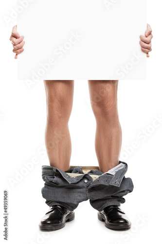 Man with pants down holding blank placard