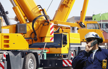 construction machinery and workers, giant cranes
