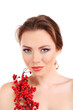 Beautiful young woman with bright make-up, holding branch with
