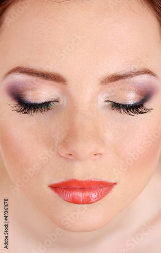 Beautiful female face with bright  make-up, close up