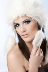 Winter beauty in fur cap