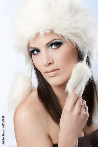 Winter beauty in fur cap