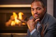 Handsome black man by fireplace