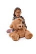 Beautiful little girl with huge plush bear