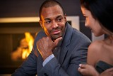 Young attractive couple by fireplace talking