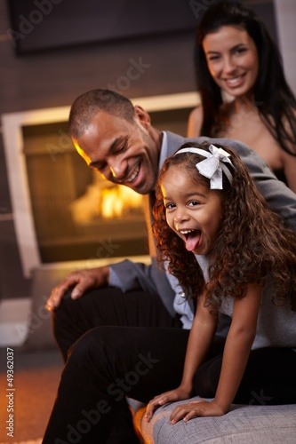 Happy diverse family having fun at home