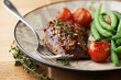 Grilled beef steak with thyme and vegetables