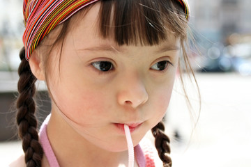 Portrait of little girl drinking water