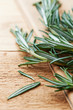 Fresh rosemary sprigs on wooden background