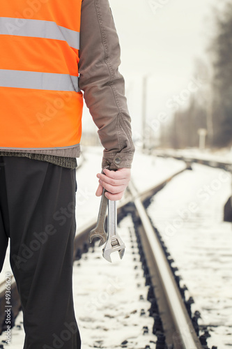Leinwandbild Motiv Worker with adjustable wrench in the hands  on railway crossings