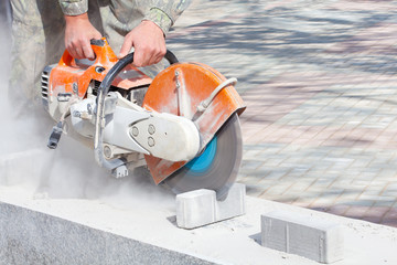 Cutting and grinding concrete or metal using a cut off saw