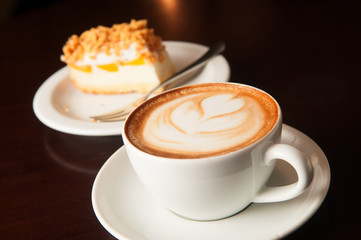 cappuccino cup with cake