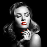 Retro Portrait Of Beautiful Woman With Cigarette