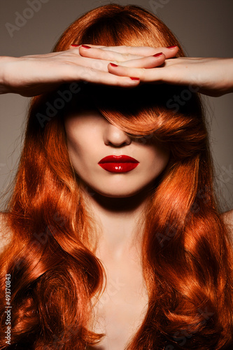Beautiful Redhair Girl.Healthy Curly Hair.