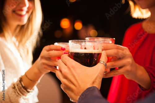 Friends having a round of drinks
