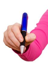 Weibliche Hand mit Kugeschreiber