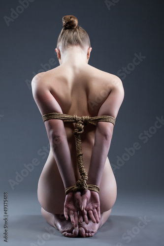 Staande foto Akt Nude young woman with shibari
