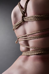 Back of young woman with shibari