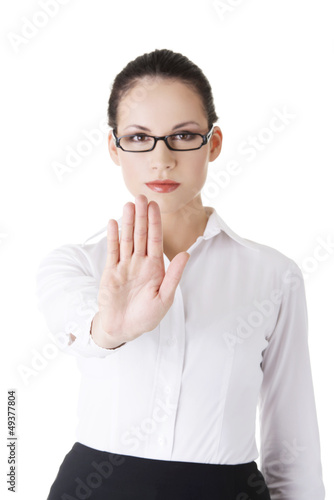 Serious businesswoman gesturing stop